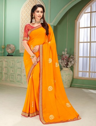 Orange printed festive wear saree