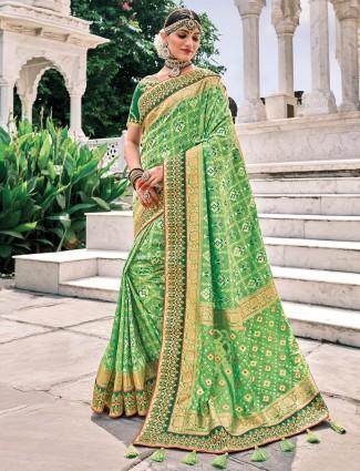 Pastel green charming wedding events patola silk saree