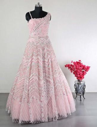 Peach net wedding wear gown for women