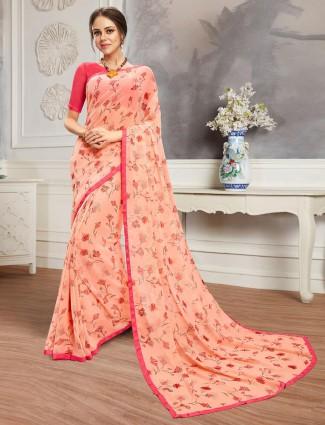 Peach print saree in georgette festive wear