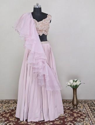 Pink colored ruffle lehenga in georgette