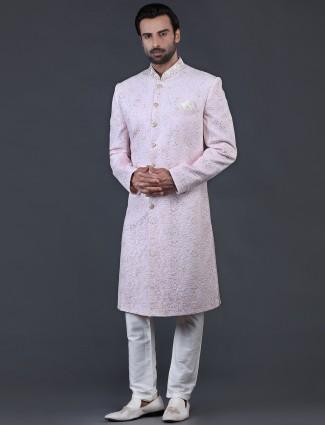 Pink net fabric sherwani for wedding occasions