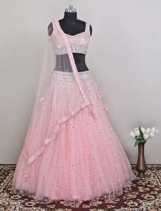 Pink wedding wear net lehenga with beads work details