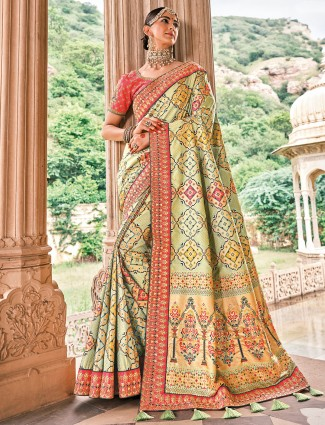 Pista green bandhej patola silk wedding saree
