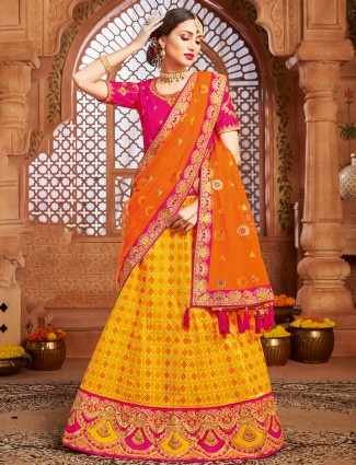 Popular bright yellow wedding patola silk unstitched lehenga choli