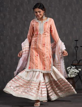 Punjabi style festive wear peach cotton kurti set