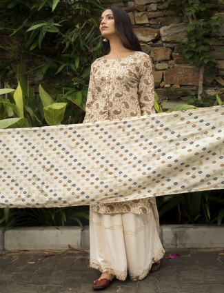 Punjabi style printed peach cotton palazzo suit for festivals