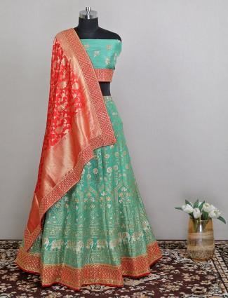 Raw silk wedding wear green lehenga choli
