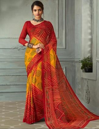 Rich yellow and red printed chiffon bandhani saree