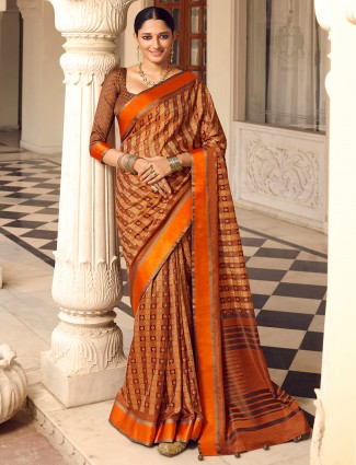 Rust orange patola silk saree for wedding occasions