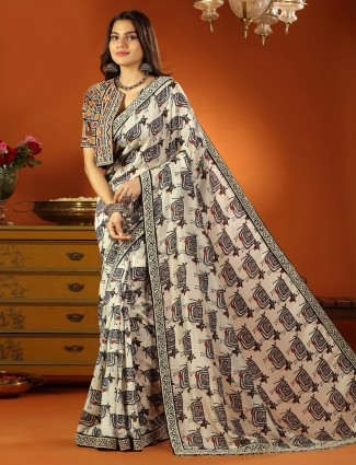 Soft silk wedding event printed saree in off white with ready made blouse