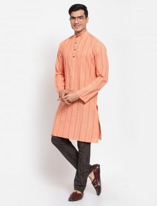 Solid style orange tint kurta with churidar for men