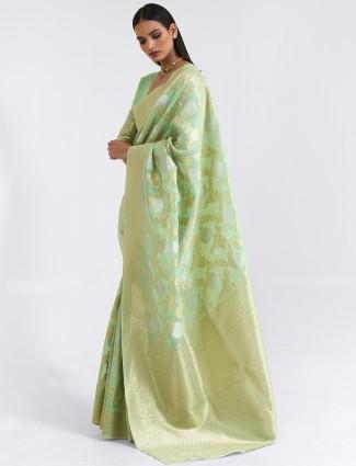 Splendid sea green festive events cotton linen saree