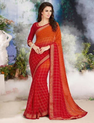 Stunning red and orange printed georgette saree for festive wear
