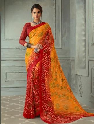 Stunning red and yellow printed chiffon bandhani saree