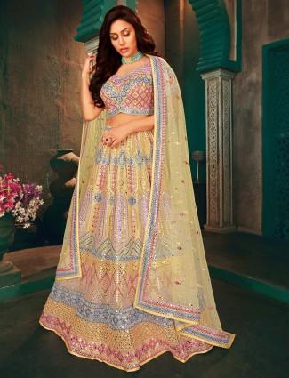 Stunning yellow lehenga choli for wedding occasions in net
