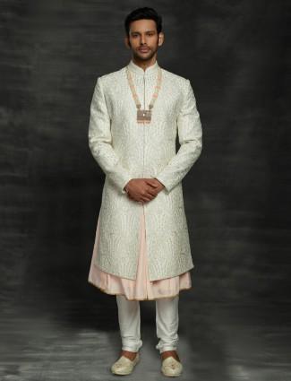 Stylish off white silk double layer sherwani for groom