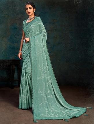 Stylish sea green colored marble chiffon saree