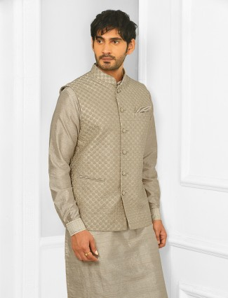 Thread decorated festive wear waistcoat suit in chickoo tint