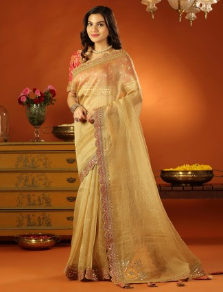 Tissue silk wedding event saree in gold with ready made blouse