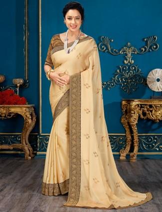 Trendy cream chiffon saree for festive look