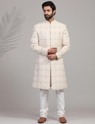 Trendy cream hue sherwani in silk for groom