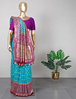Trendy green silk wedding wear saree