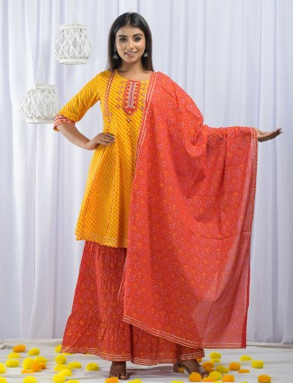Turmeric yellow punjabi printed festive wear cotton sharara suit