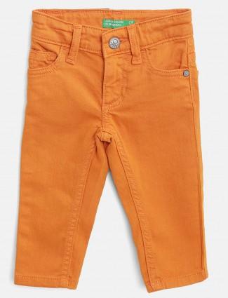United Colors of Benetton orange hued jeans