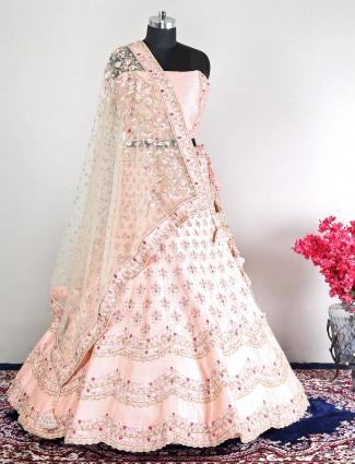 Unstitched peach raw silk wedding wear lehenga choli