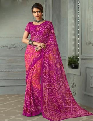 Purple and pink printed chiffon bandhani saree for festive