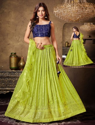 Wedding events parrot green and navy georgette lehenga choli