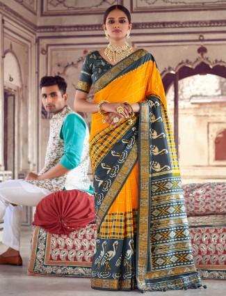 Wedding functions ochre yellow patola silk saree