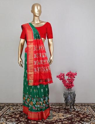 Wedding wear dark green patola silk saree