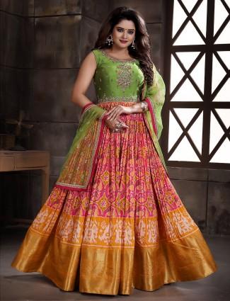 Wedding wear floor length patola silk anarkali suit in pink hue