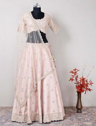 Wedding wear peach lehenga choli in raw silk
