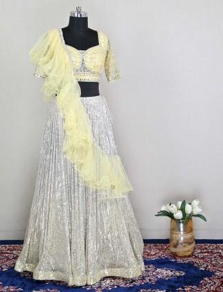 Wedding wear yellow net lehenga choli