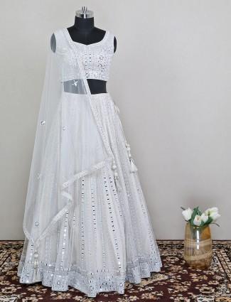 White colored net lehenga choli