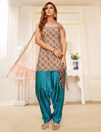 yellow and peacock blue printed silk dhoti suit