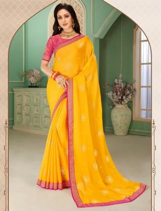 Yellow chiffon festive wear saree