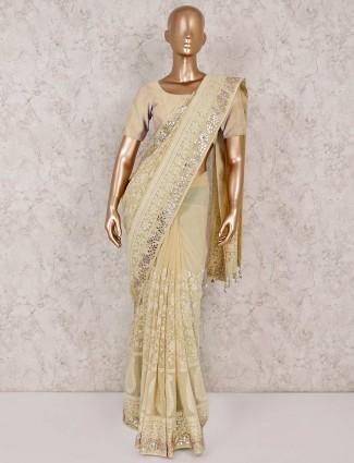 Yellow georgette lakhanvi saree