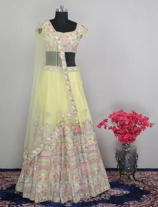 Yellow gorgeous wedding wear net lehenga choli