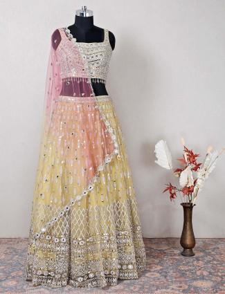 Yellow net lehenga choli for wedding ceremonies