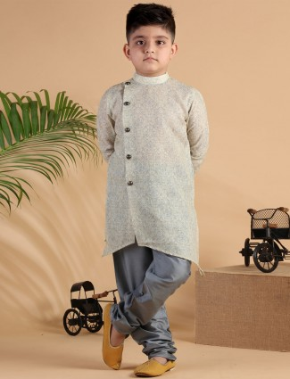 Yellow printed festive wear silk kurta suit