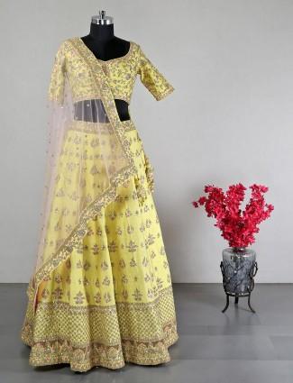 Yellow raw silk lehenga choli for wedding days