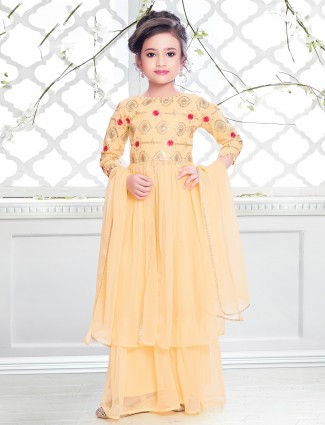 Yellow shade wedding wear palazzo suit for girls