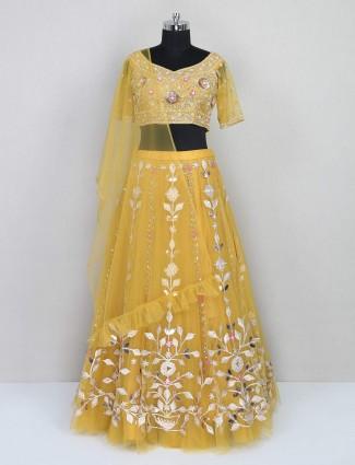 Yellow wedding wear net lehenga choli