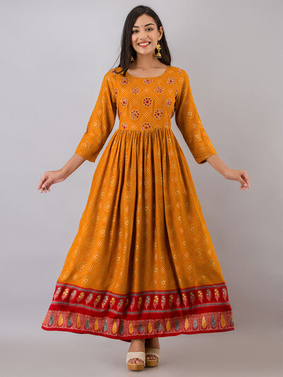 Mustard printed casual wear cotton kurti