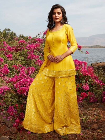 Opulent yellow georgette punjabi style wedding wear sharara suit
