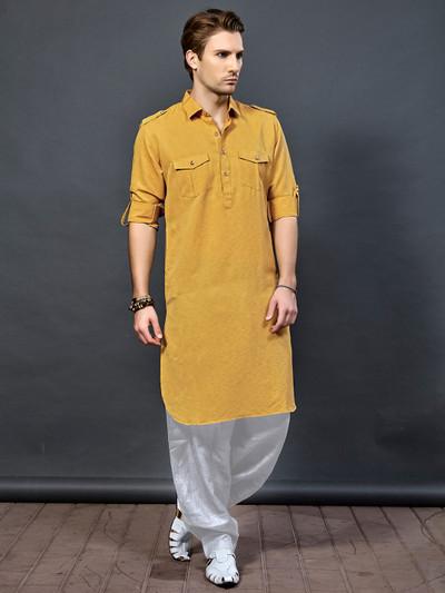 Orange color pathani suit for festive wear